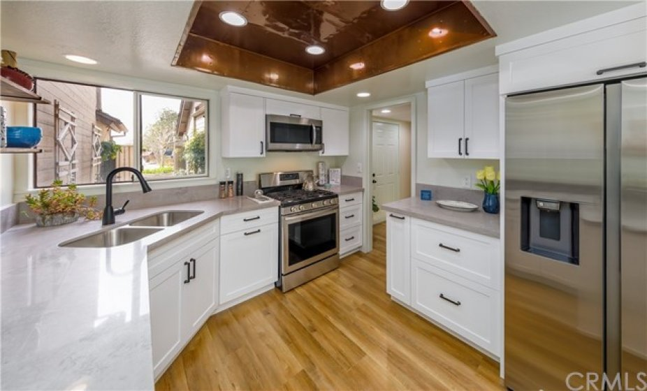 Stainless steel sink, new faucet and the appliances are BRAND NEW!
