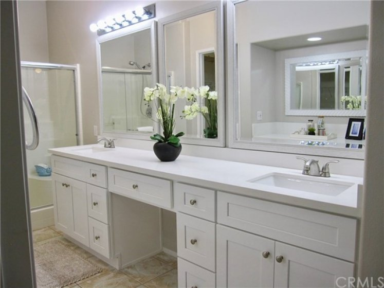 Master bathroom with new double sinks vanity, counters, mirrors. Walk in shower to the left.