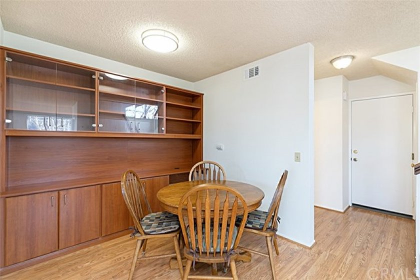 Dining Room area with built-in cabinet looking toward the door into the Garage and Downstairs Bathroom just to the left