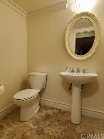 Powder room adjacent to living & kitchen area