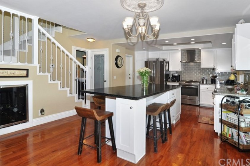 Custom Island in Dining area with Granite counter top.  Wine cooler, large pantry,  gorgeous glass backsplash in kitchen, and newer stainless steel applicances.