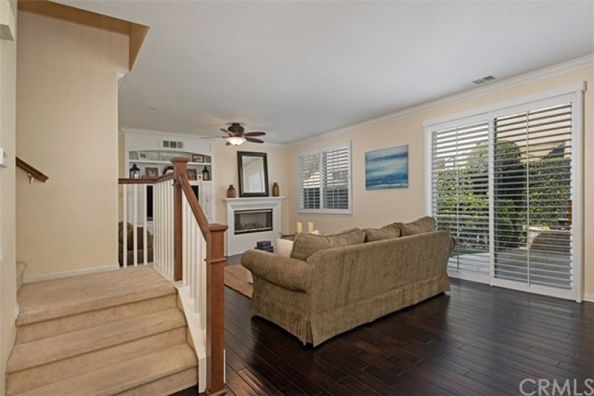 The gleaming wood floors on the main level give a warm greeting as you enter the front door