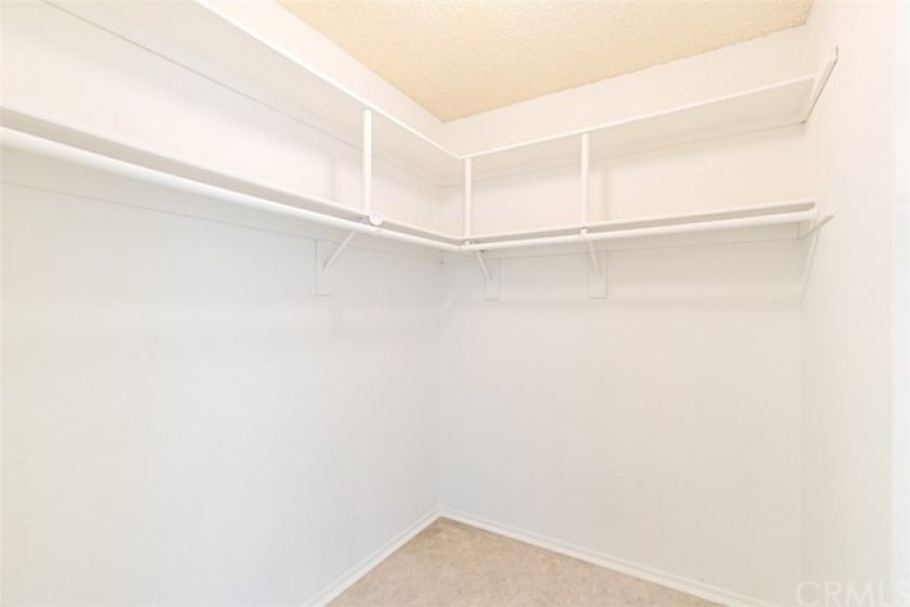 Walk-In Closet off of the Master Bedroom overlooking the pool area