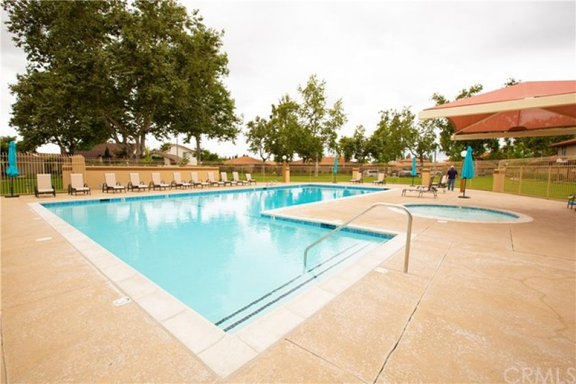 HOA pool with all new seating and umbrellas, solar heating to be installed for year round use