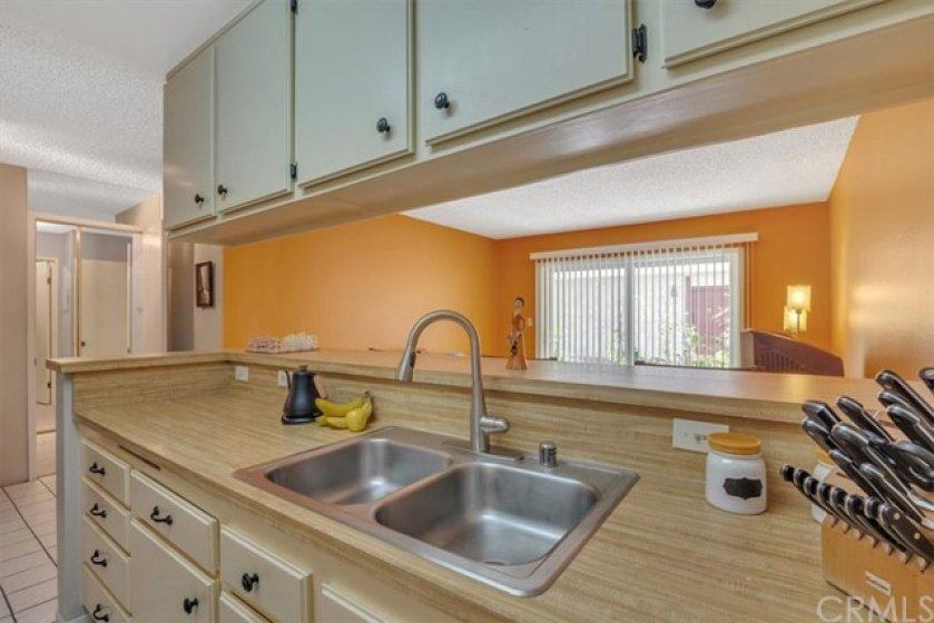 Stainless Steel Sink and Plenty of Kitchen Cabinets.