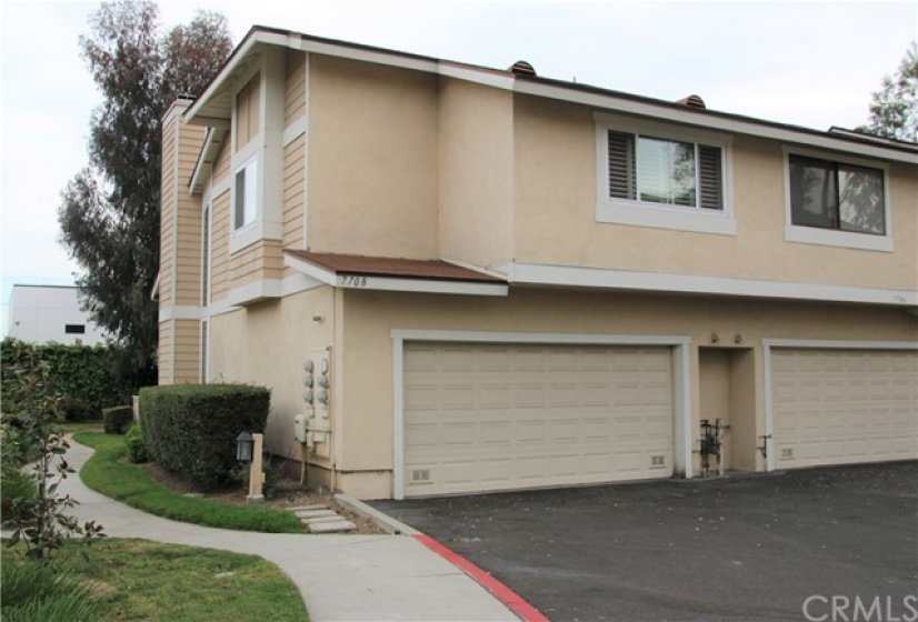 Direct access two car garage. Insulated sectional door with opener.
