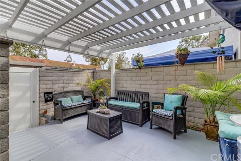 The patio is located right off the kitchen and dining area so it is perfect for entertaining. The overhead trellis provides some shade and looks charming.