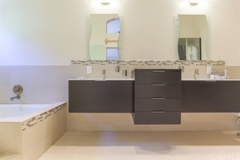 Luxurious master bath features dual sinks, separate tub and shower!