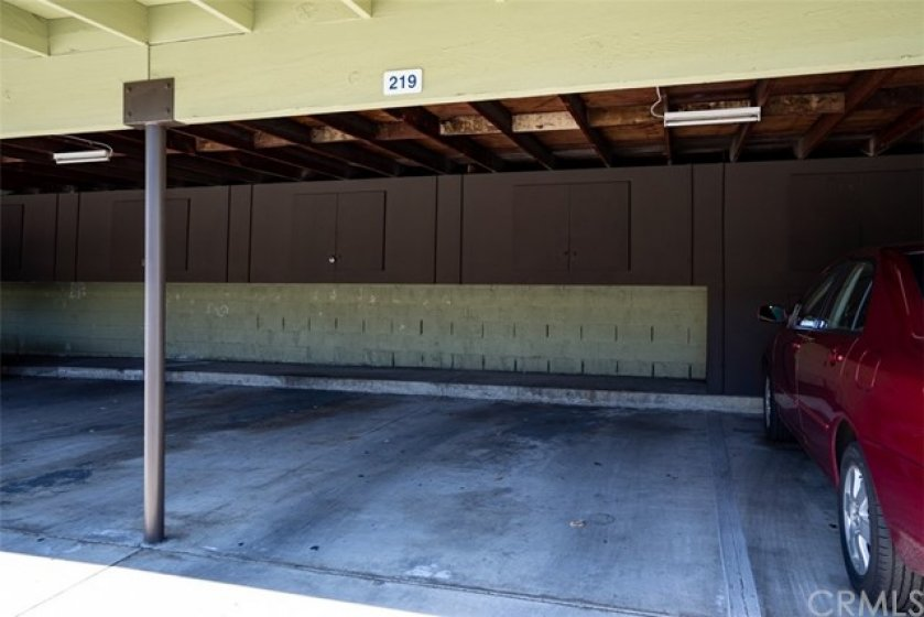 Assigned carport with storage unit above