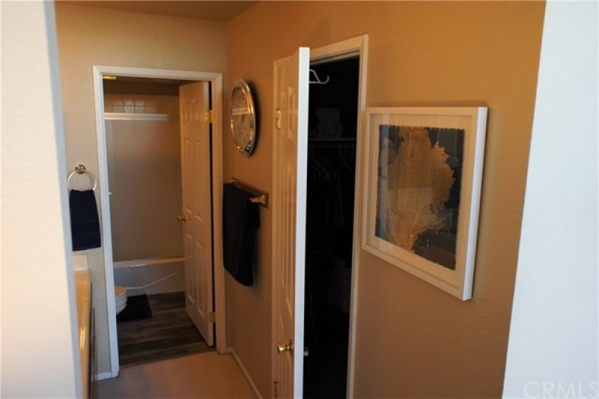 Master walk-in closet with extra storage.