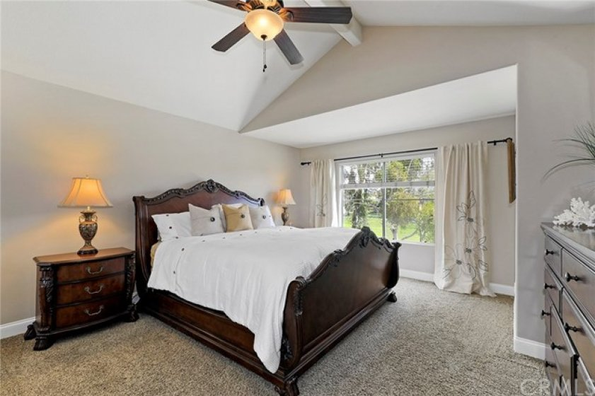 Master Bedroom with vaulted ceilings and a spectacular view of the golf course