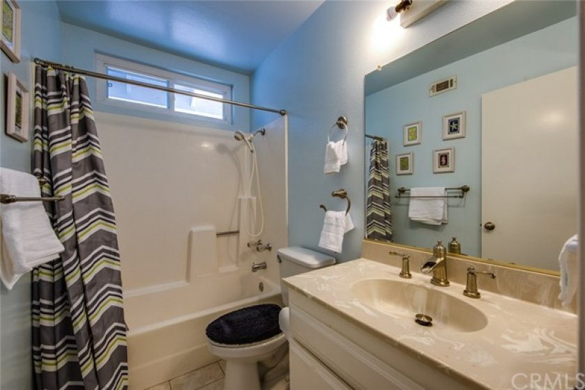 A closer look at the private full bath for the secondary upstairs bedroom.