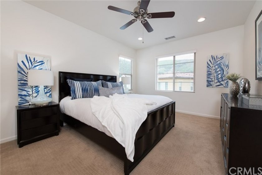 master bedroom with ceiling fans