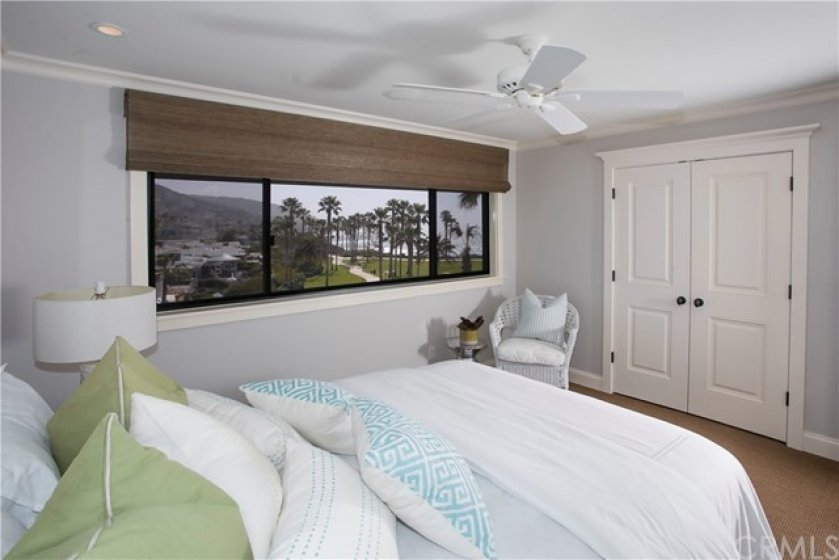 GUEST BEDROOM OVERLOOKING TREASURE ISLAND PARK.  LAUNDRY INSIDE CLOSET WITH STAIRS LEADING TO FINISHED ATTIC.