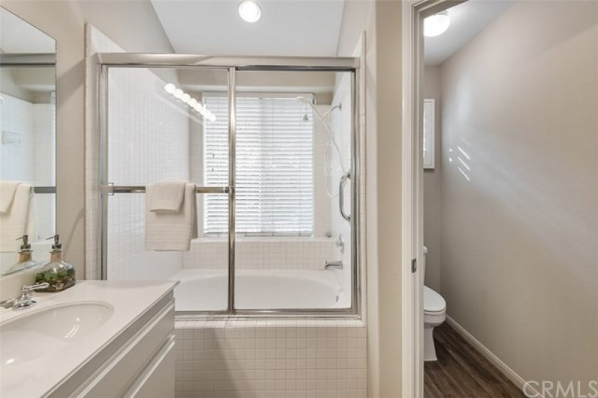 Master Bathroom with new water resistant vinyl flooring in the private water closet, new carpet, new paint, new light fixture, large soaking tub, and unobstructed views of the canyon.