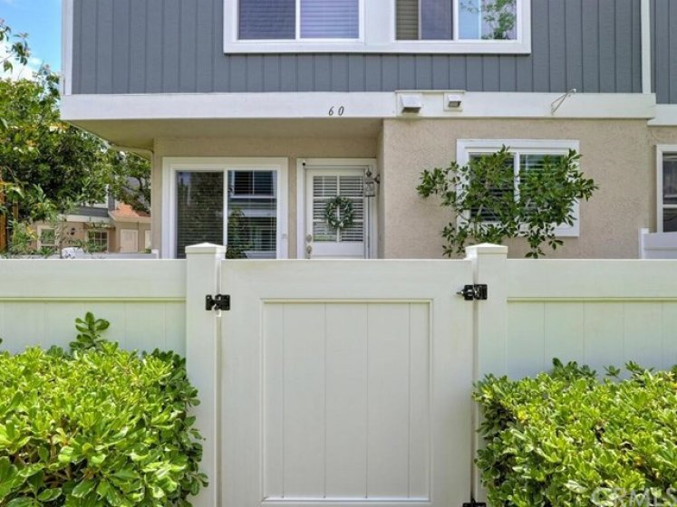 The front entry is surrounded by a front patio providing privacy and extra space.