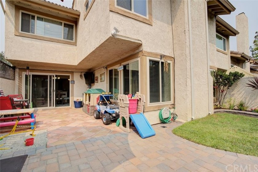 interlocking pavers, sand box, real grass, end unit/only 1 neighbor