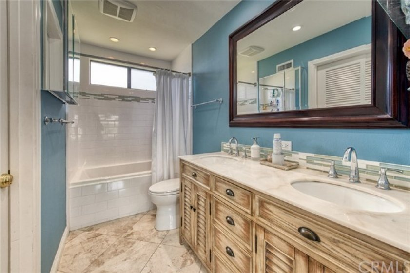 Master Bathroom with jetted tub, dual vanity and walk-in closet.