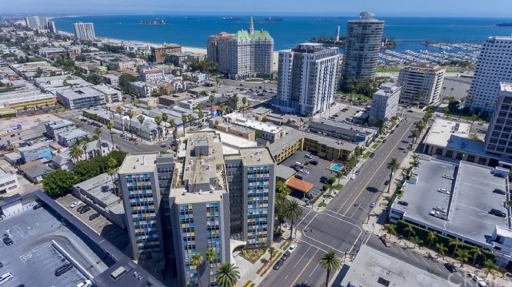 The Royal Palms is one block back from Ocean Boulevard and the beach. Iconic mid-century architecture! It's 11 stories tall with 2 penthouses on the rooftop. This condo is on the 10th floor with VIEWS