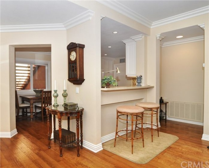 Rich wood floors, dining area and breakfast bar.
