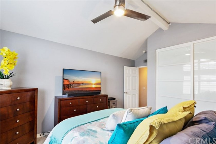 This home has raised panel interior doors throughout. This room has a sliding door closet
