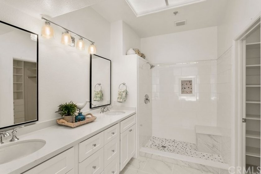 Newly remodeled master bath with custom shower, new vanity, flooring, counters, fixtures and updated master closet.