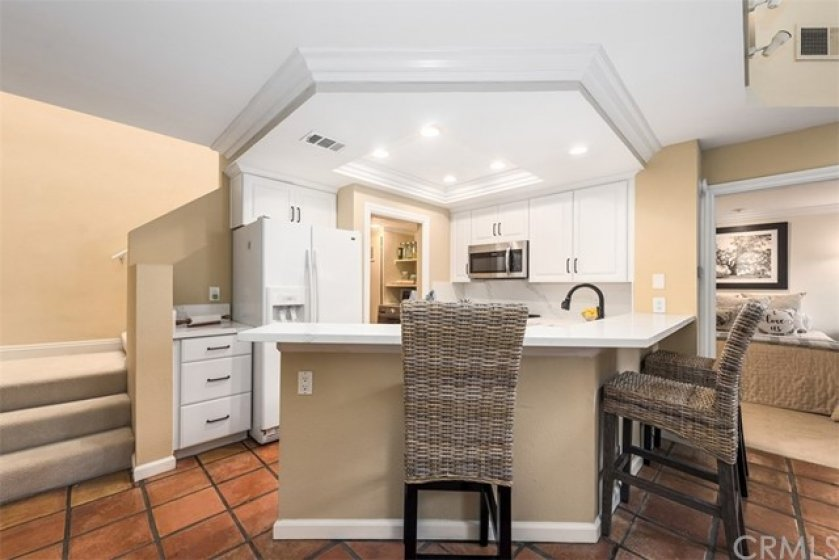 NEWLY UPDATED Bright Kitchen features New Cabinets, Quartz Countertop, Deep soak Stainless Steel sink, NEW Stove and Dishwasher and Recessed lighting. Plenty of counter space to create your finest meals and entertain your guests.