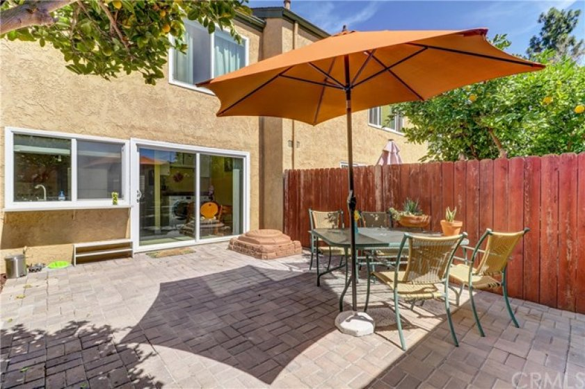 Enormous patio that leads directly to your own private 2-car garage. Beautiful pavers for low-maintenance.