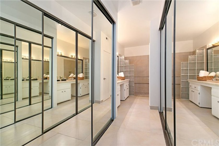 Dual mirrored closets in master bath