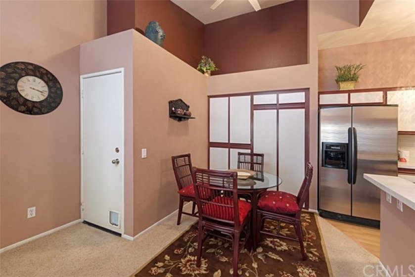 Dining area with door leading you to your attached garage.
