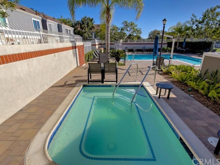 Set back on the interior of the neighborhood, 60 Allenwood is still a short walk to the large community pool and spa.