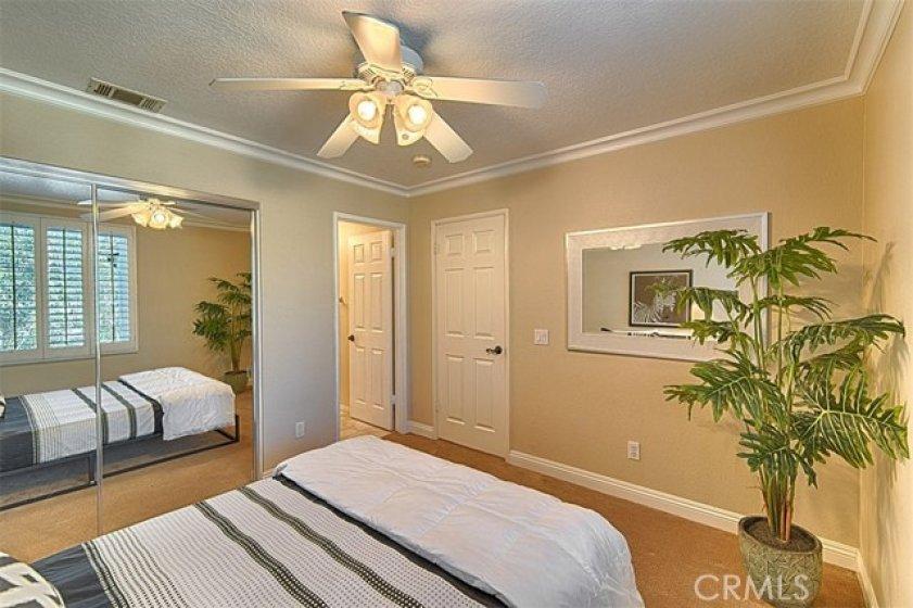 Upstairs bedroom suite with mirrored closet doors.