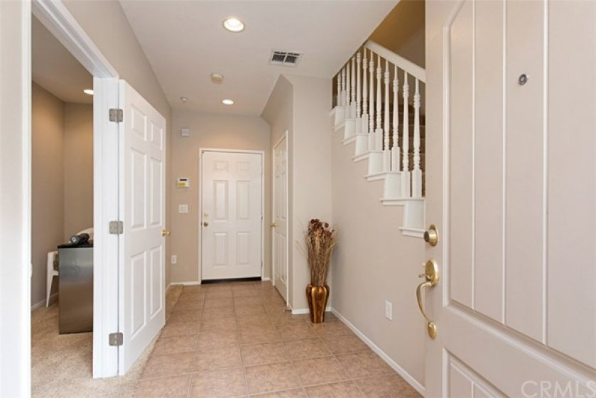 Main level entry.  Bedroom on the left, garage access straight ahead.