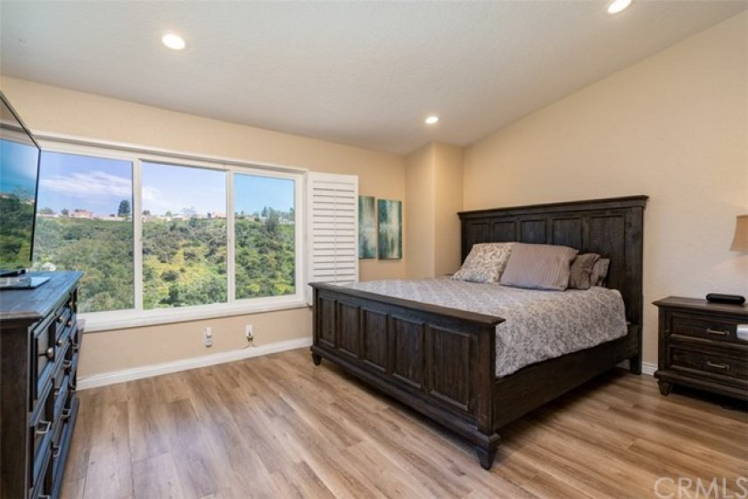 The master bedroom has amazing views of the hills and lights at night.