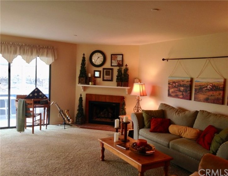 LARGE FAMILY ROOM WITH A COZY FIREPLACE