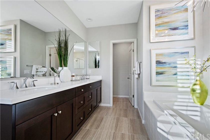Master ensuite with double sinks, separate tub and shower, upgraded flooring and light fixture.