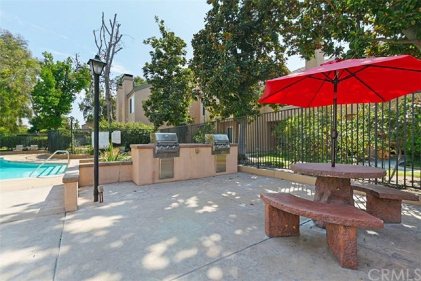 Vacation at home in the beautiful pool area with picnic tables, BBQ's, pool and spa