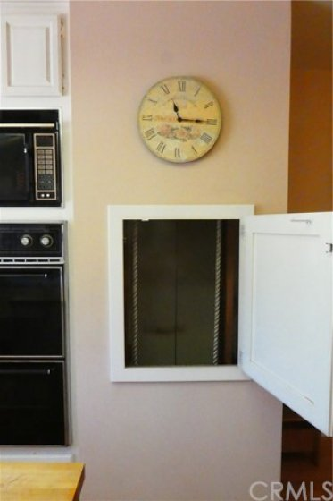 An authentic dumb waiter from kitchen to upstairs