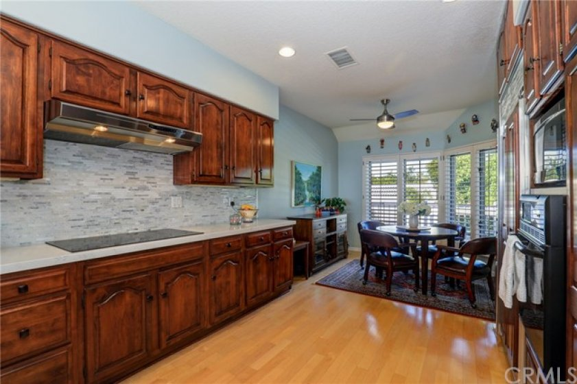 Kitchen with recessed lighting, plantation shutters, ceiling fan and breakfast nook