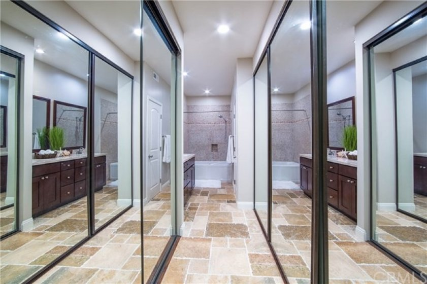 Remodeled Bath room with spa tub, traventine, mosaic tiles