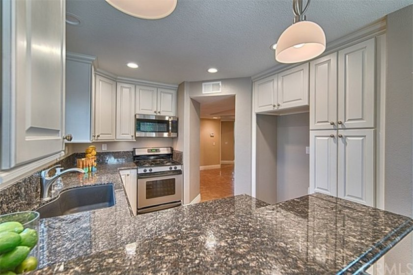 Soft closed cabinets & doors with rich dark granite counter tops.