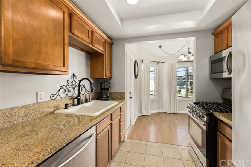 Beautiful cabinets with granite counters.