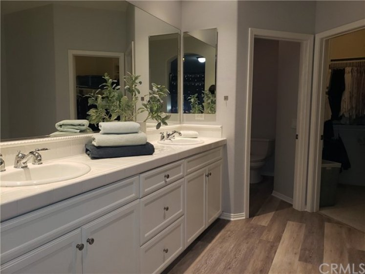 Master dual sinks, lots of storage cabinets, walk-in shower, separate soaking tub.  Beautiful!
