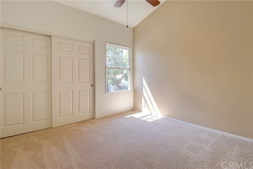 Bedroom 2 with vaulted Ceilings, Fan and new carpet