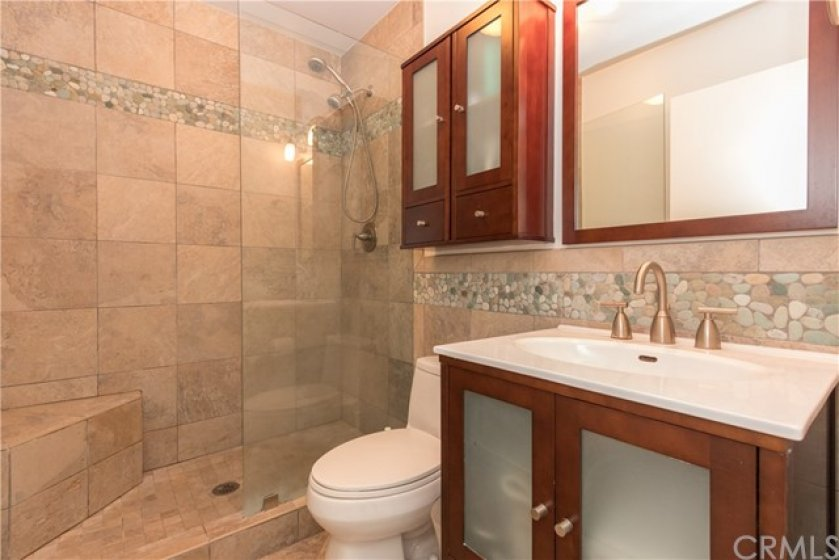 Upstairs bath with glass enclosed shower and handsome upgrades!