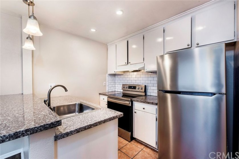 Beautiful subway tile backsplash, granite countertops with stainless steal appliances in your new kitchen!
