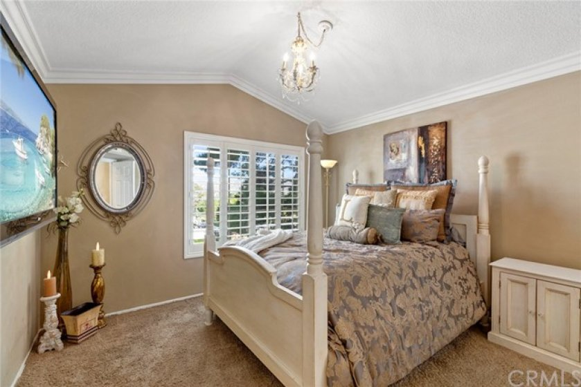 Master bedroom with vaulted ceiling- Crown molding- Plantation shutters