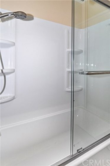 """New master bath shower with 18"""" soaking tub and glass door"""