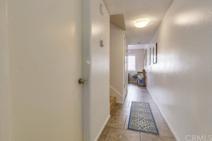 downstairs hallway also with nice tile flooring.