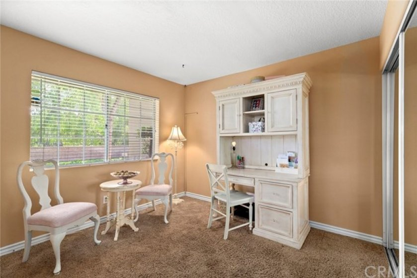 Downstairs bedroom- Currently being used as an office with glass sliding closet doors- Raised baseboards- Finished ceiling